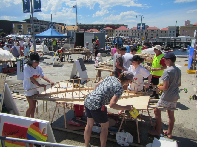 School Kids building simple skin on frame boats during the festival.